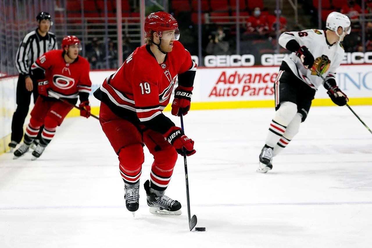 FILE - In this May 6, 2021, file photo, Carolina Hurricanes' Dougie Hamilton (19) skates with the puck against the Chicago Blackhawks during the third period of an NHL hockey game in Raleigh, N.C. Hamilton would be among the most coveted free agents. He's a 28-year-old right-shooting defenseman who can produce offensively. (AP Photo/Karl B DeBlaker, File)