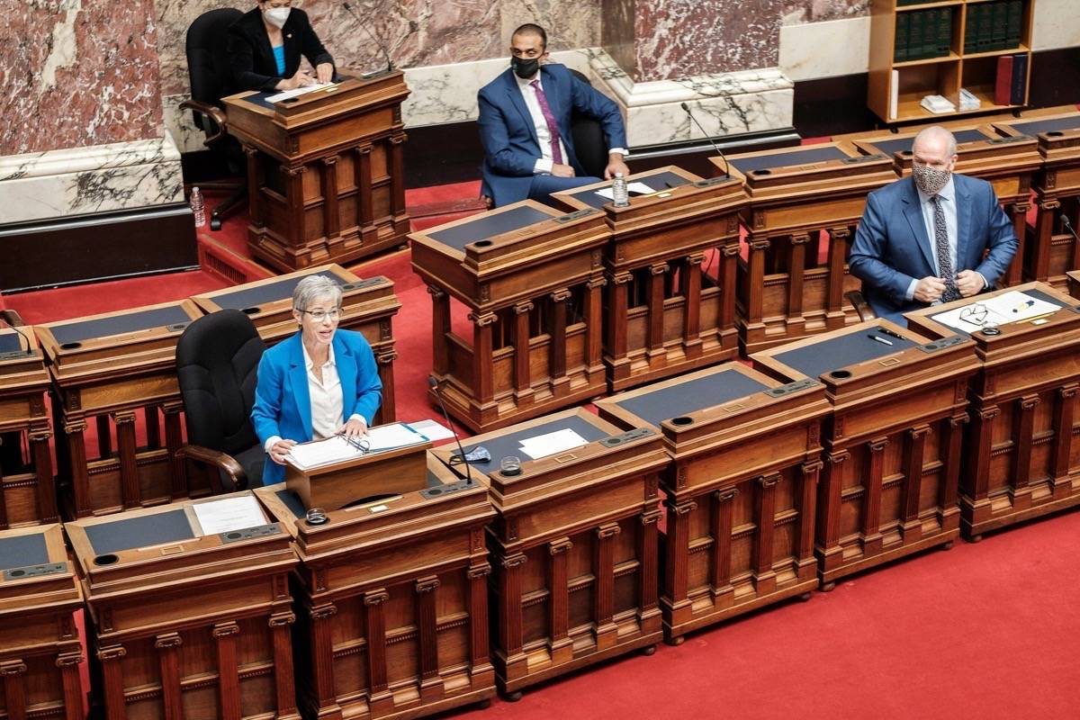 B.C. Premier John Horgan listens as Finance Minister Selina Robinson presents the province's latest budget, April 20, 2021. The budget forecasts $19 billion in deficits over three years. (Hansard TV)