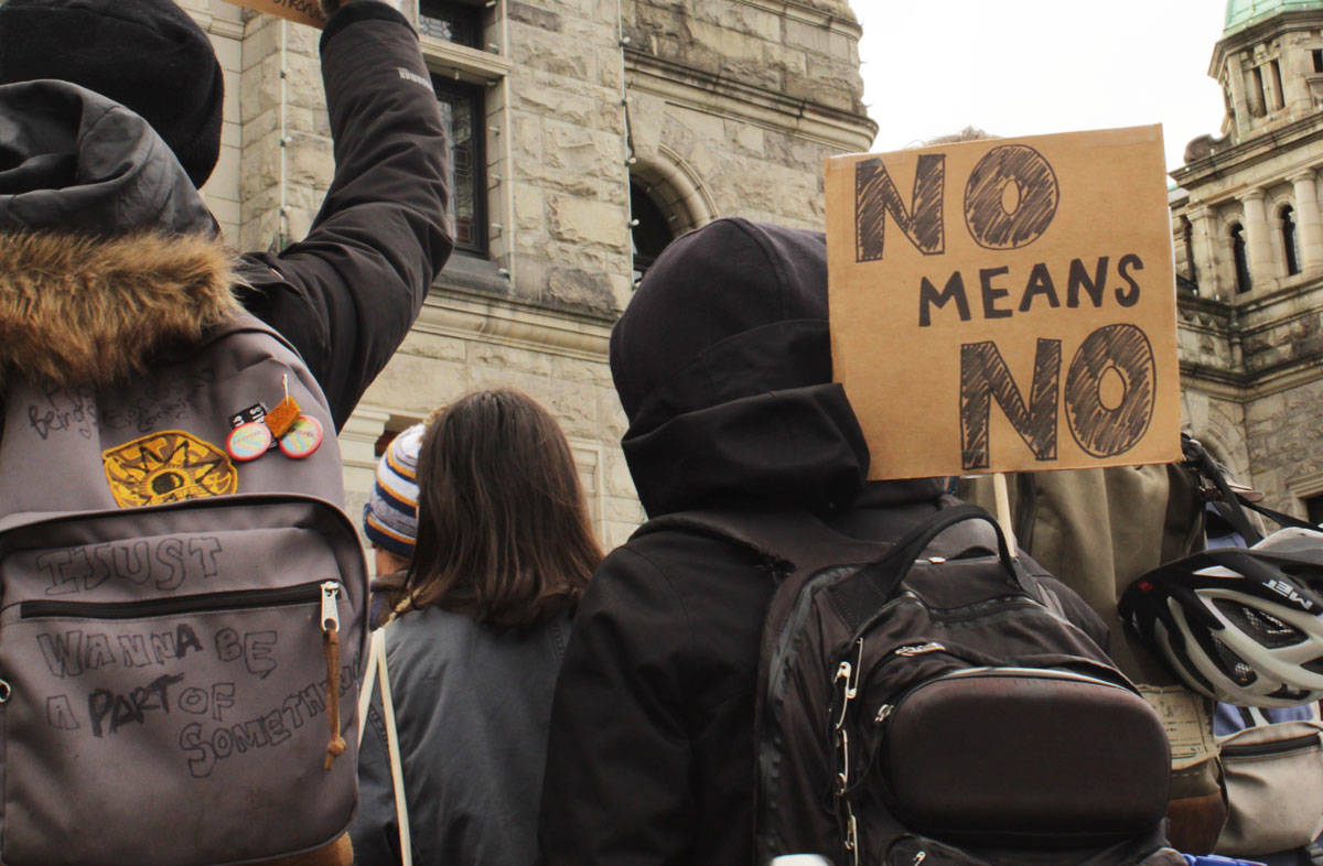 Attendees at the 2020 Women's March in Victoria carry signs with messages of empowerment. (Black Press Media file photo)