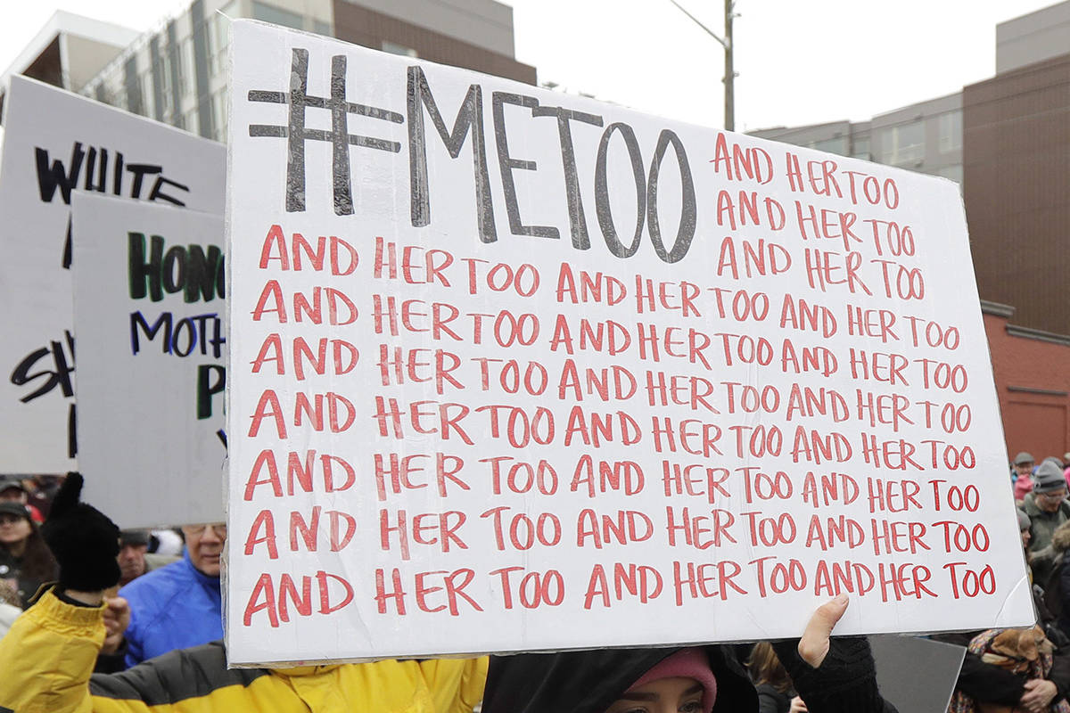 In this 2018 photo, a marcher carries a sign with the popular Twitter hashtag #MeToo used by people speaking out against sexual harassment as she takes part in a Women's March in Seattle. (AP Photo/Ted S. Warren, File)