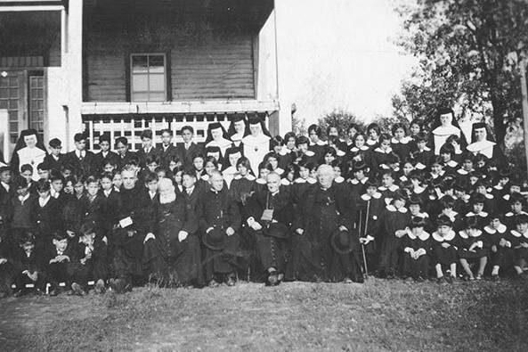 Students in front of the school at Fort Alexandre are shown in this handout image from 1935 provided by the archives of the Société historique de Saint-Boniface. THE CANADIAN PRESS/HO-Archives of the Société historique de Saint-Boniface