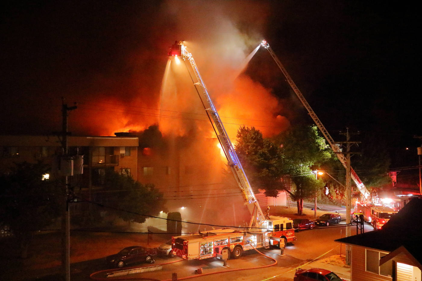 Chilliwack firefighters tackle a blaze at an apartment fire on Hazel Street in Chilliwack in the early hours of July 29, 2021. (Eric Buermeyer photo)