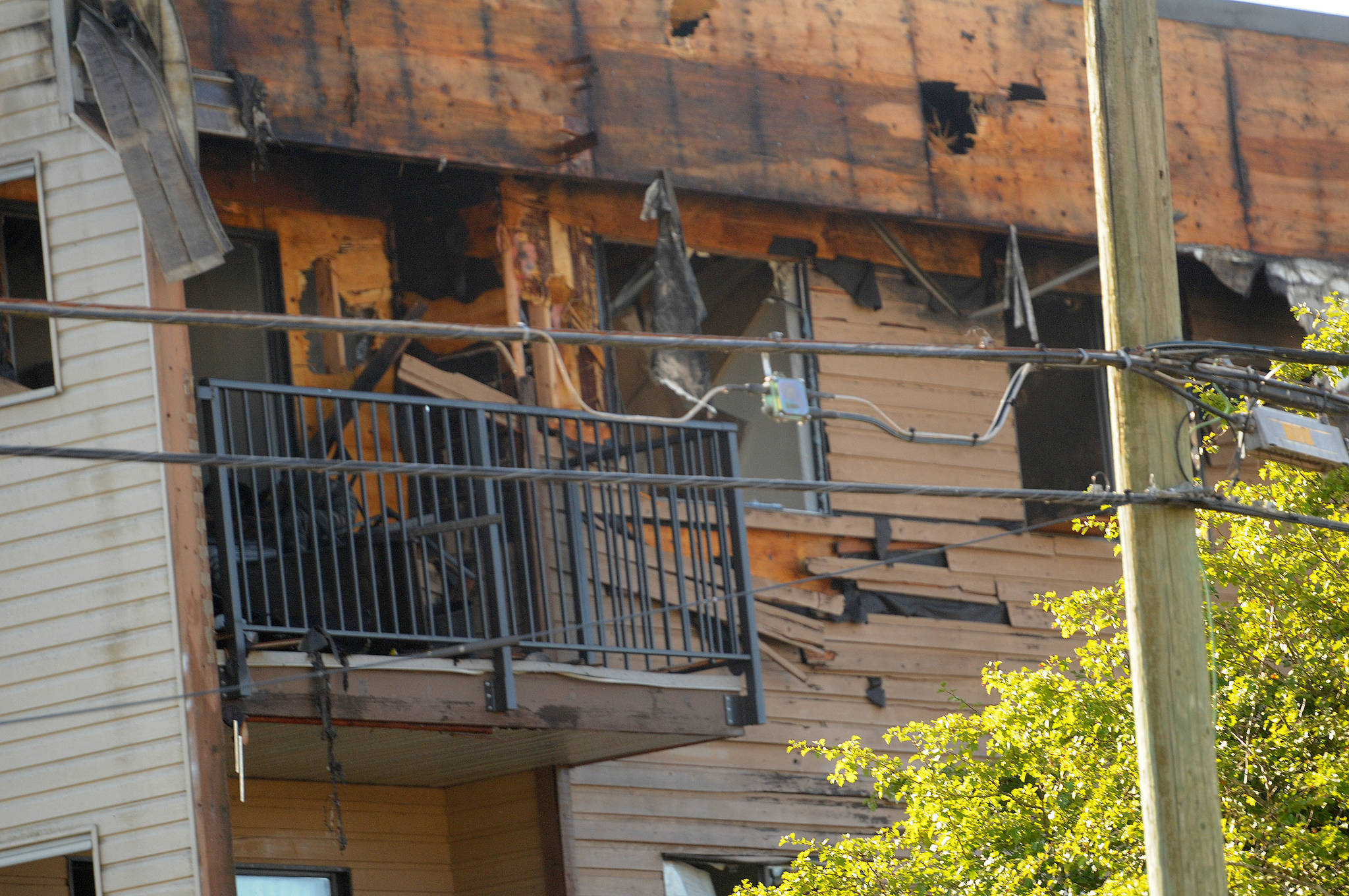 A corner unit on the fourth floor of a Hazel Street apartment building shows particularly bad damage after an overnight fire on July 29, 2021. (Eric J. Welsh/Chilliwack Progress)