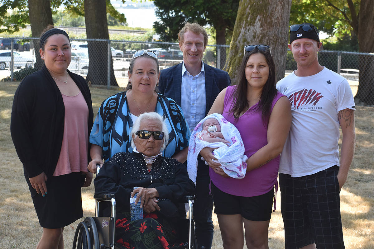 Generations of Semiahmoo First Nation welcoming federal Indigenous Services minister Marc Miller (back centre) to Semiahmoo Park on July 28 included (left to right) Leanne Wells, Coun. Joanne Charles, Mabel Charles, plus one-month-old Arya Kampen and parents Samantha Wells and Daniel Kampen. (Alex Browne photo).