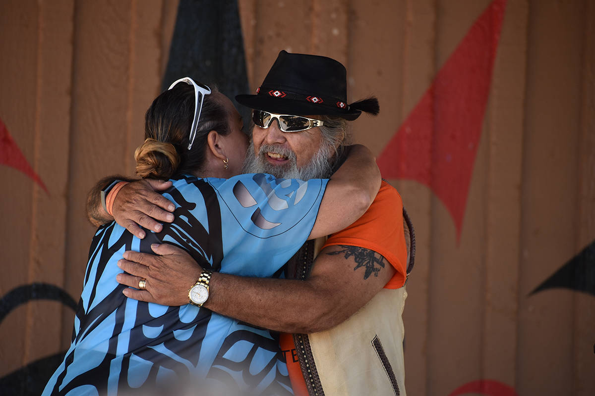 Semiahmoo First Nation Councillor Joanne Charles and former Chief Willard Cook share a celebratory hug at a July 28 event marking the lifting of the boil water advisory on Semiahmoo lands. (Alex Browne photo)