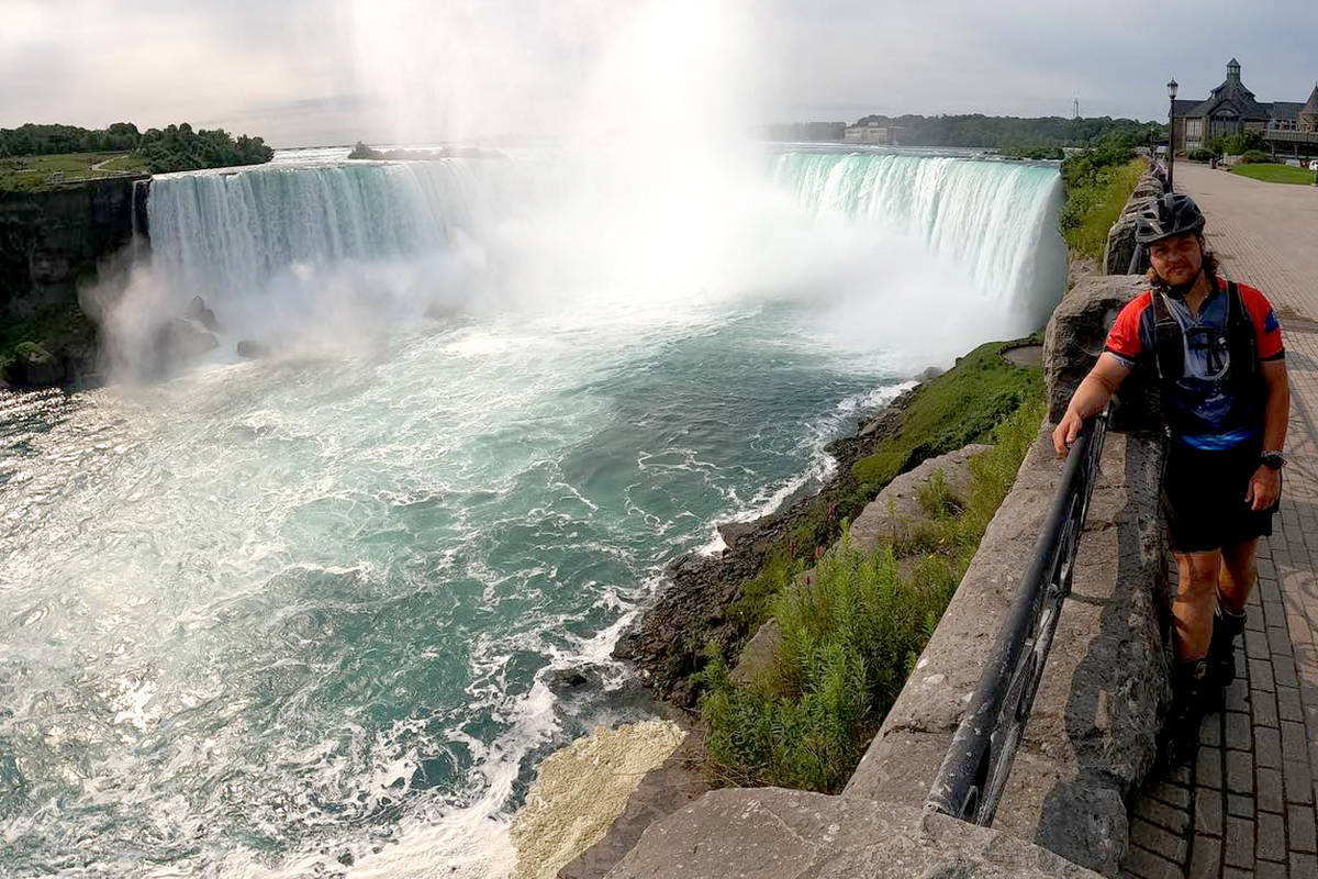Aldergrove's Zach Choboter stopped to take in the view of Niagara Falls on his cross-country rollerblading journey. (Special to The Star)