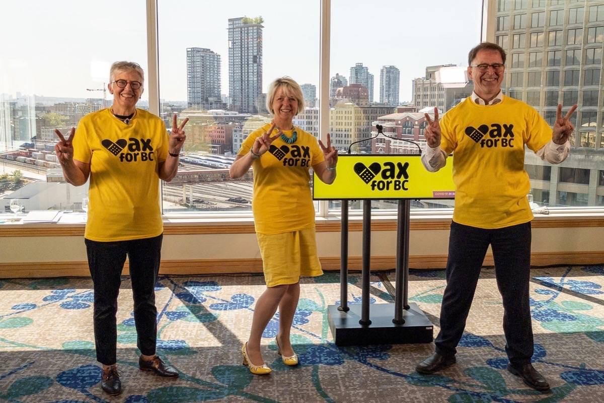 Dr. Penny Ballem, leader of B.C.'s COVID-19 vaccine program, provincial health officer Dr. Bonnie Henry and Health Minister Adrian Dix promote new website offering walk-in clinics around the province, at the cabinet offices in Vancouver, July 26, 2021. (B.C. government)