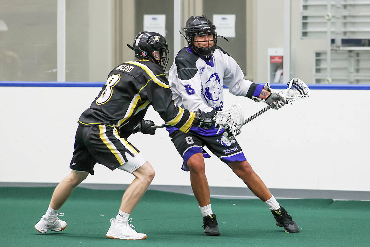 Andrew Joseph is watched by a Port Coquitlam Saints defender during BC Junior Tier 1 Lacrosse League action at Langley Events Centre on July 27. Joseph scored three times as the Thunder rallied for a 12-10 victory. (Damon James/Langley Events Centre)