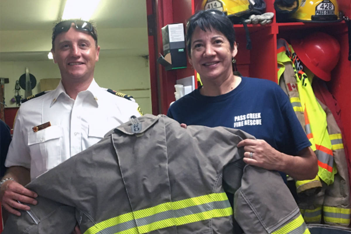 Firefighter Sue Idle (right) with Pass Creek Fire Department chief Aaron Bebelman. Photo: Submitted