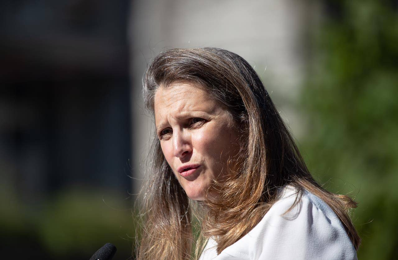 Chrystia Freeland, Deputy Prime Minister and Minister of Finance, responds to questions after a social housing funding announcement in the Downtown Eastside of Vancouver, on Wednesday, July 28, 2021. Freeland says the government is extending pandemic aid programs by an extra month beyond the previously planned end date. THE CANADIAN PRESS/Darryl Dyck