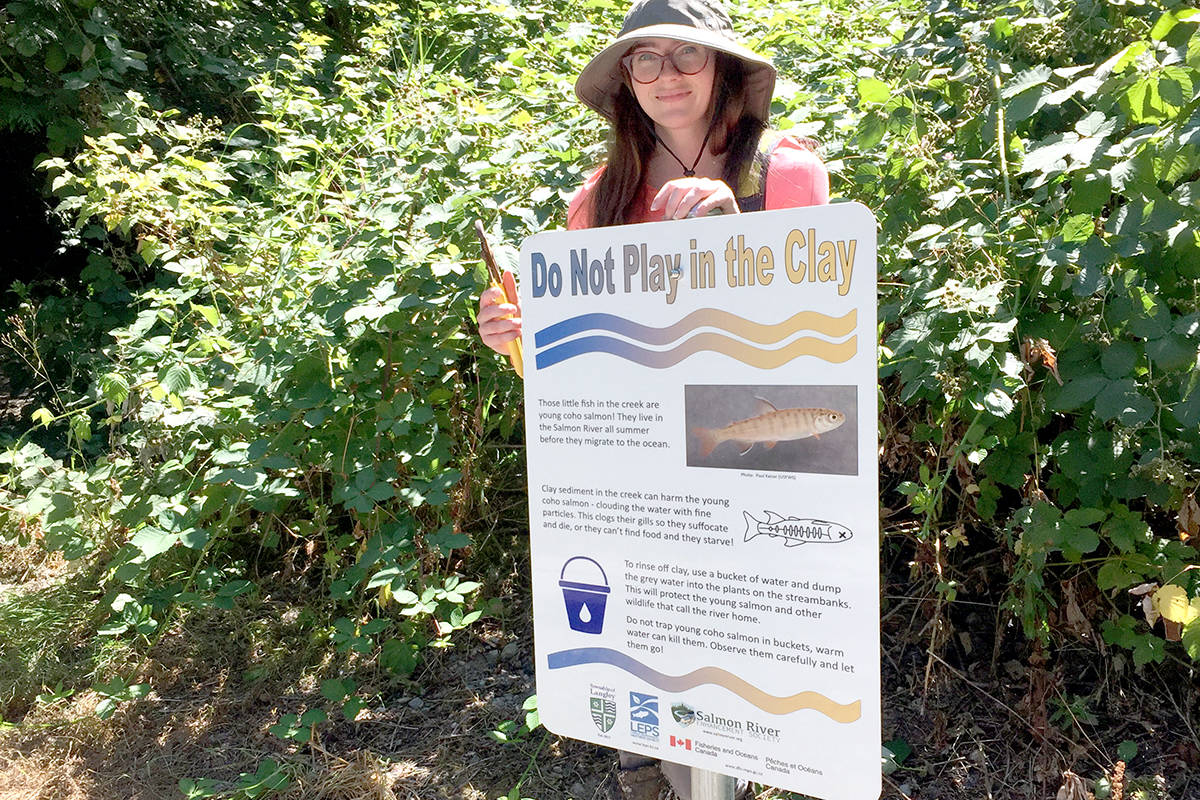 Elyse Dyke helped put a sign in Williams Park warning people not to disturb clay deposits. (Special to The Star)