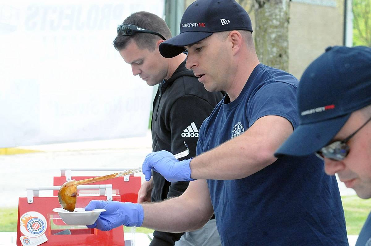 A firefighter ladles out a sample at the 2019 Canadian Festival of Chili and BBQ in Langley City, which has raised more than $60,000 for the Young Burn Survivors Camp run by the B.C. Professional Firefighters' Burn Fund. Organizers have just announced the event will have to be cancelled for a second year. (Langley Advance Times file)