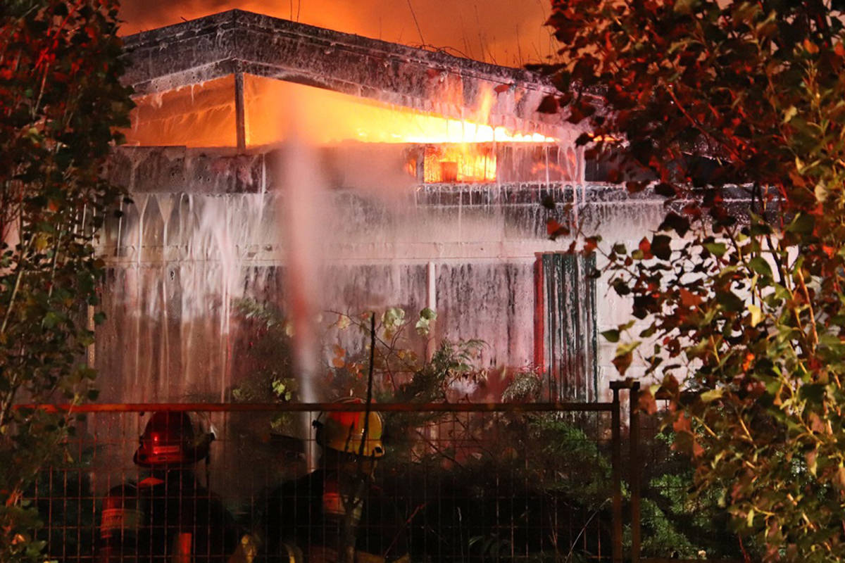 )  Fire ripped through a vacant house in the 2600 block 208th St in Langley Sunday morning. (Shane MacKichan/Special to Langley Advance Times)