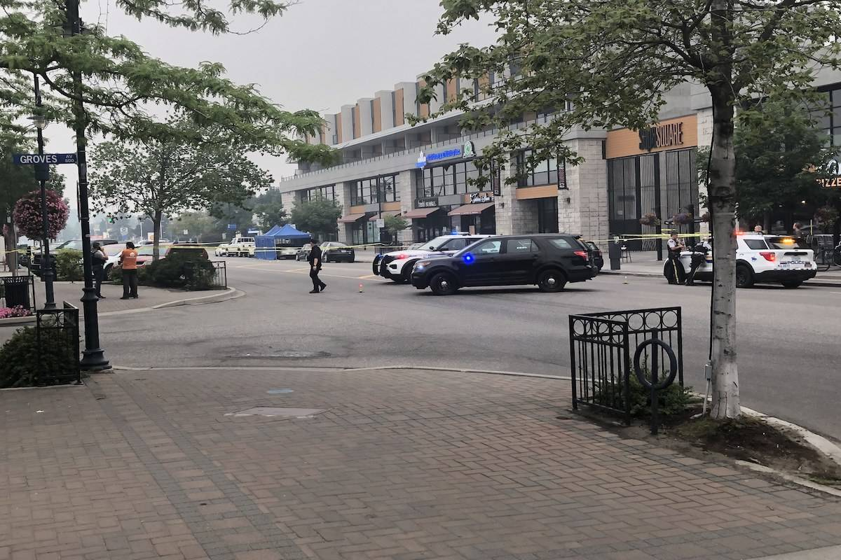 The area between Pandosy Street and KLO Road remains cordoned off as RCMP investigate a suspected targeted shooting that sent two men to the hospital on Saturday, July 31. (Jef Hill/Contributed)