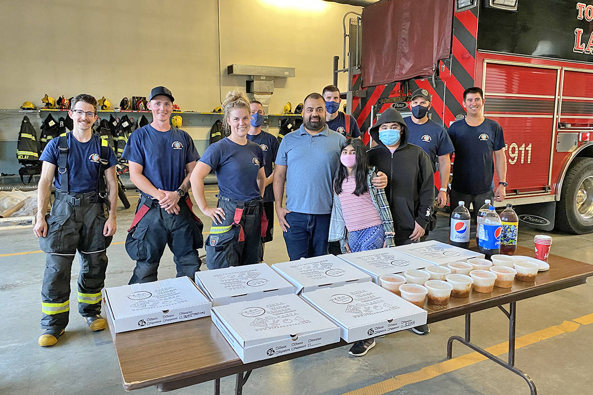Yes, they deliver. Pizza Mantra owner Hiten Gupta (centre) and his kids dropped by the firehall at 96th and 208 with some thank-you pizzas. (Special to Langley Advance Times)