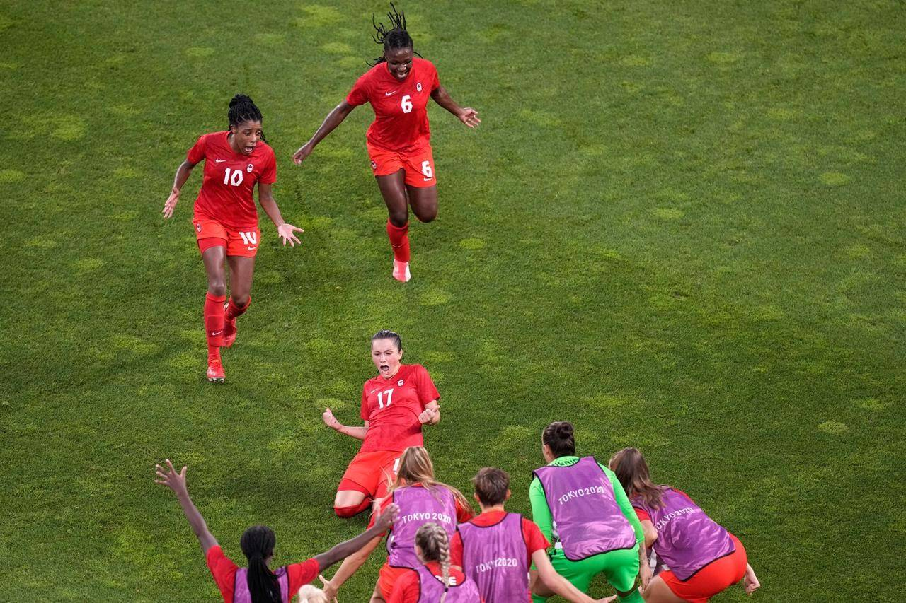 Canada's Jessie Fleming, 17, celebrates scoring the opening goal from the penalty spot during a women's semifinal soccer match against United States at the Tokyo Summer Olympic Games, in Kashima, Japan, Monday, Aug. 2, 2021. Fleming scored on a penalty kick in the 74th minute to help the Canadian women's soccer team to a 1-0 semifinal victory over the United States on Monday at the Tokyo Games. THE CANADIAN PRESS/AP-Martin Mejia