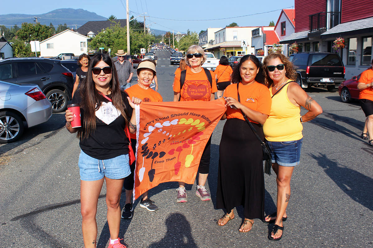 At the Penelakut Tribe's March for the Children, from left: Emmy Manson, Sandy Good, April Devoy, Charsanaa Johnny and Wanda Good from the Snuneymuxw First Nation. (Photo by Don Bodger)