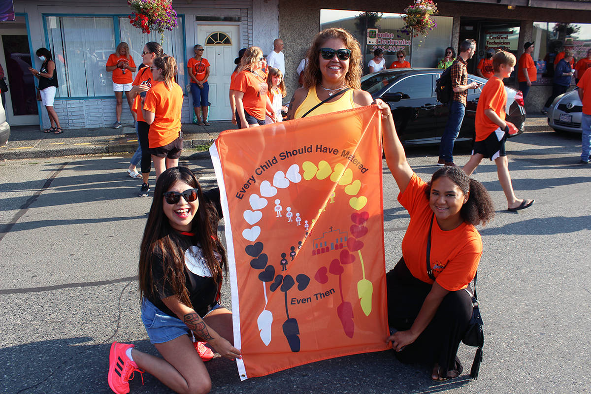At the Penelakut Tribe's March for the Children, from left: Emmy Manson, Wanda Good and Charsanaa Johnny from the Snuneymuxw First Nation. (Photo by Don Bodger)