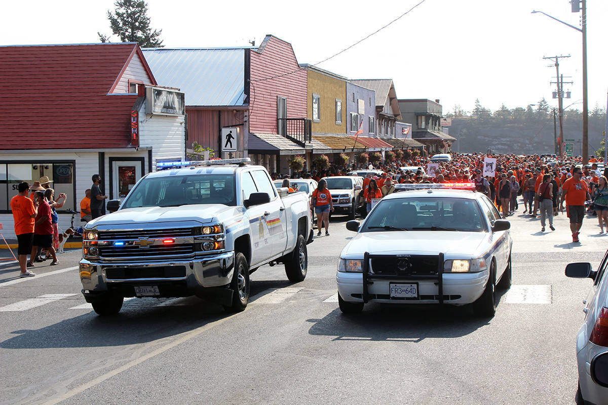 Police cars line up at the start of the march. (Photo by Don Bodger)