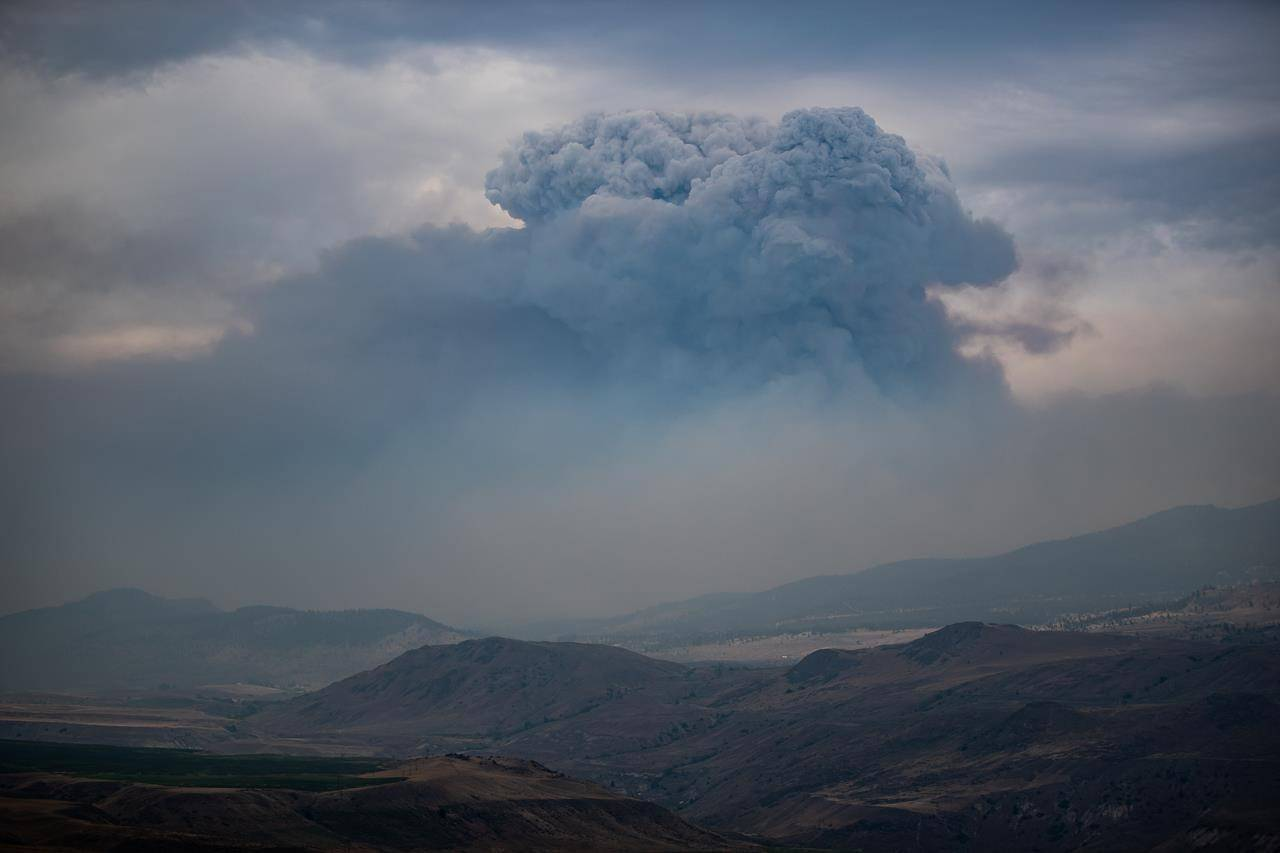 A pyrocumulus cloud, also known as a fire cloud, forms in the sky as the Tremont Creek wildfire burns on the mountains above Ashcroft, B.C., on July 16, 2021. THE CANADIAN PRESS/Darryl Dyck
