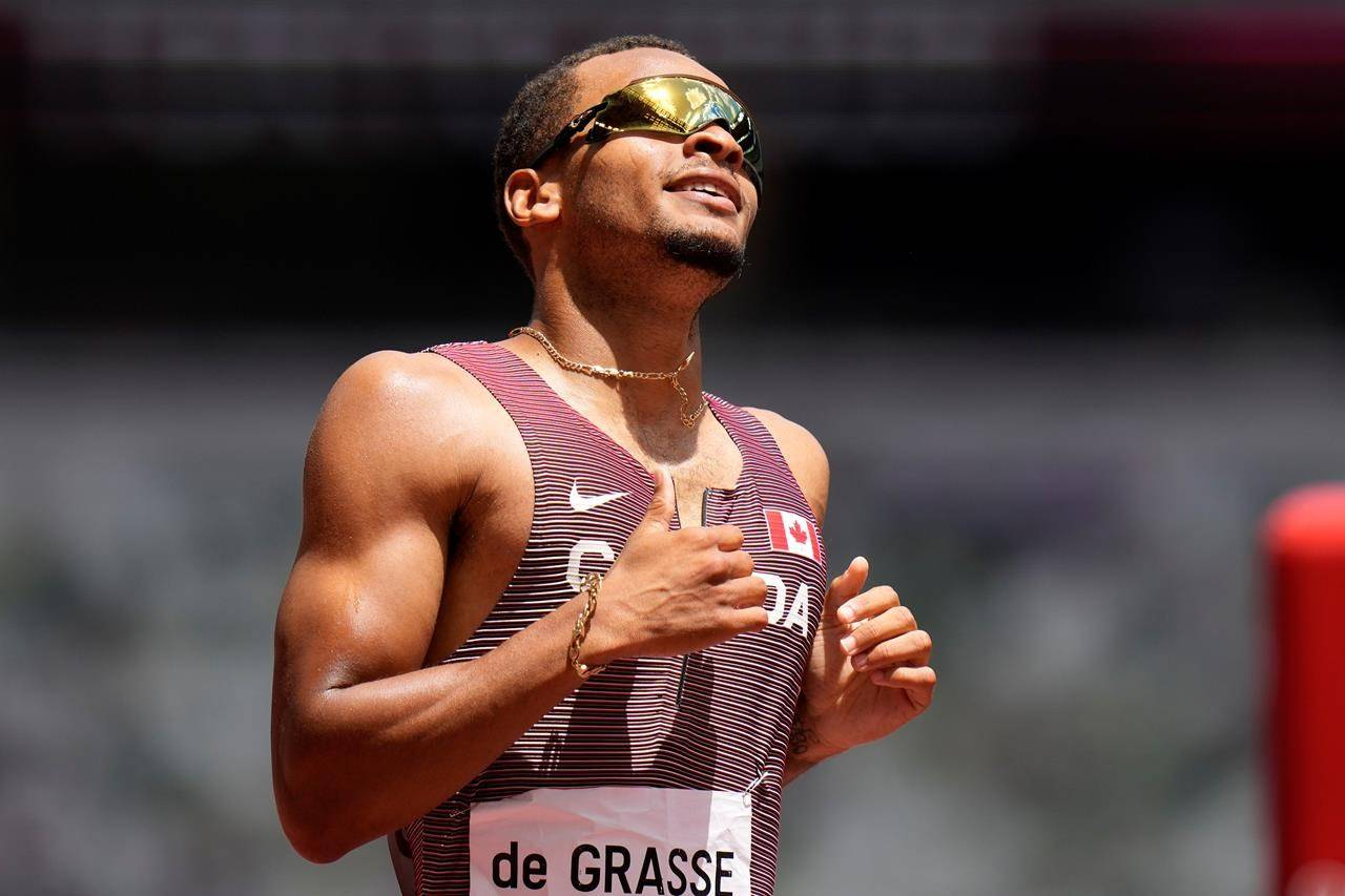 Andre De Grasse, of Canada, competes in a heat of the men's 200-meters at the 2020 Summer Olympics, Tuesday, Aug. 3, 2021, in Tokyo. THE CANADIAN PRESS/AP/Petr David Josek