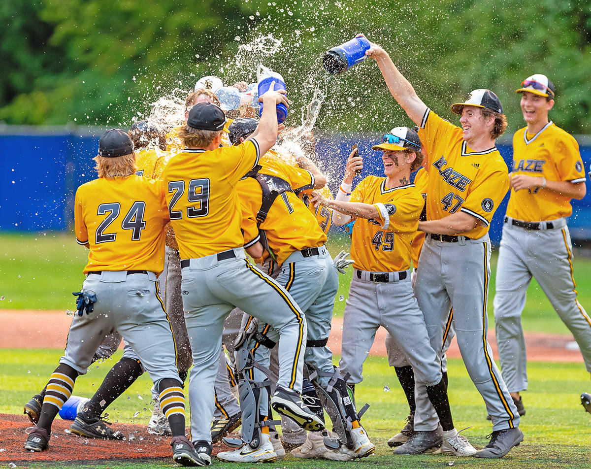 Langley Blaze celebrate winning the championship game of the 2021 BCPBL playoffs against Victoria Aug. 1. Langley took the title with a 13-1 victory. (Christian J. Stewart Photography/special to Langley Advance Times)