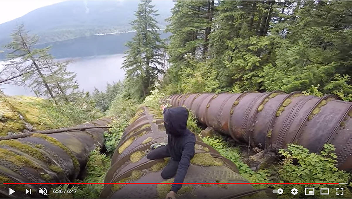 Video still shows a person who trespassed at BC Hydro's Buntzen Lake Dam, climbing penstocks to post for followers on his YouTube channel. Image courtesy BC Hydro/YouTube