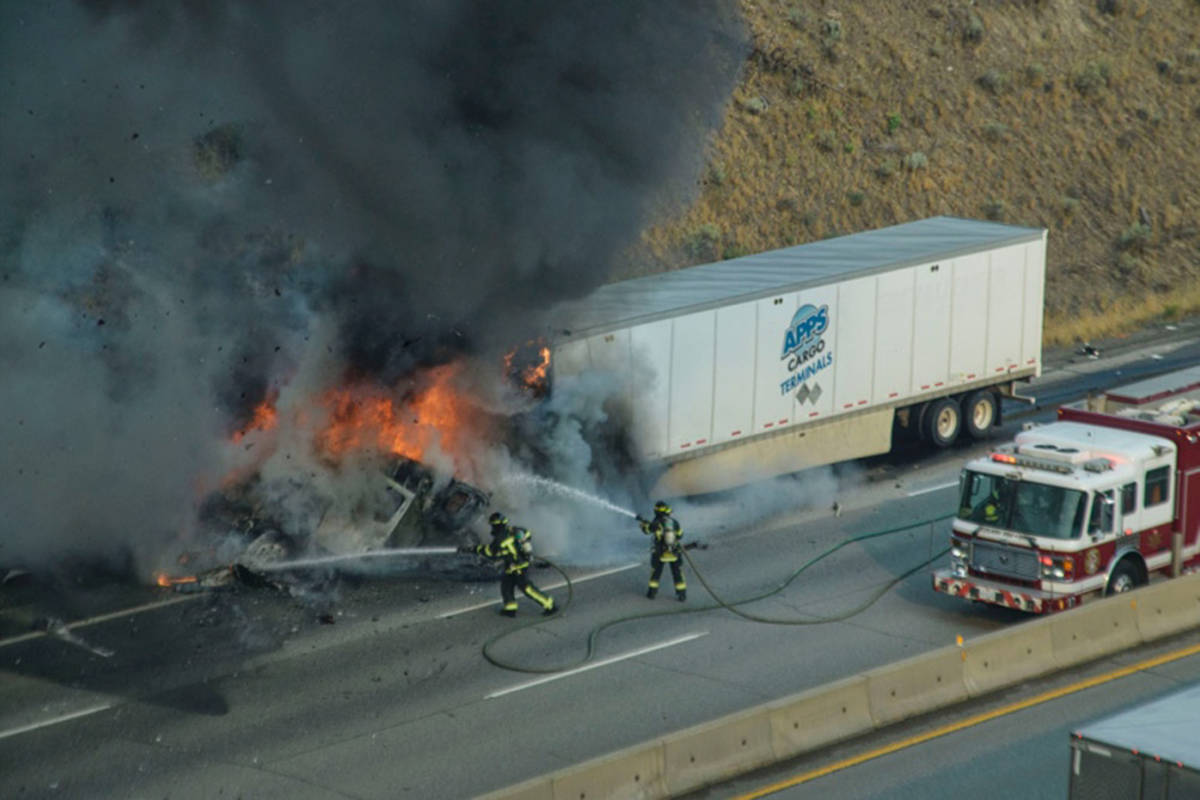 Firefighters attack the flames after a collision on Highway 1 in west Kamloops on Aug. 2, 2021, led to a fire and explosions. (Dave Eagles/Kamloops This Week)