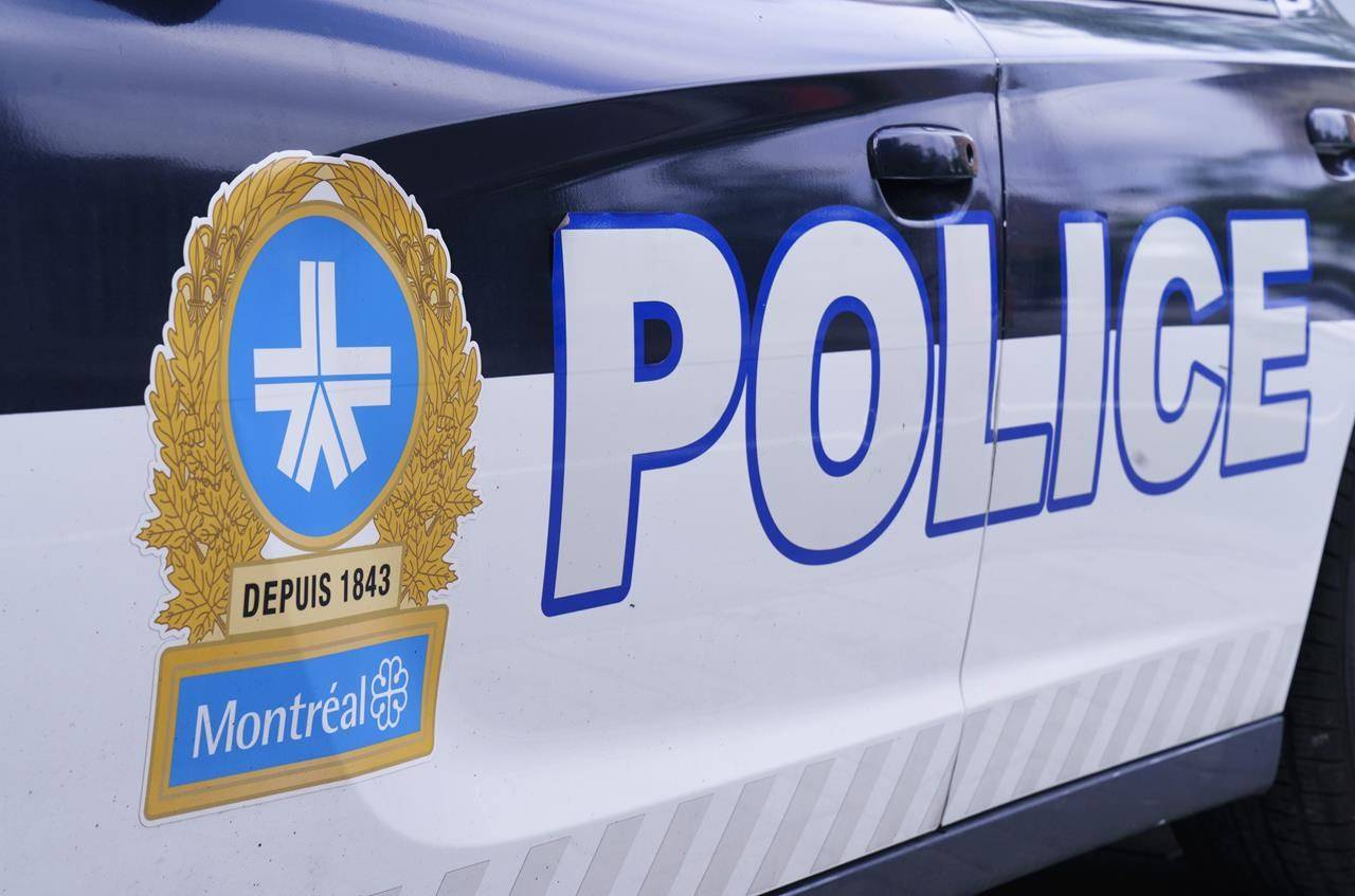 The Montreal Police logo is seen on a police car in Montreal on Wednesday, July 8, 2020.THE CANADIAN PRESS/Paul Chiasson