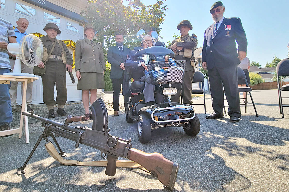 Murrayville's John Swityk (L) turned 100 on Aug. 3, surrounded by family and friends and memories, including an example of the Bren gun the self-described 'shortest guy in the regiment' carried as a member of a Canadian anti-tank platoon during the Second World War. (Dan Ferguson/Langley Advance Times)