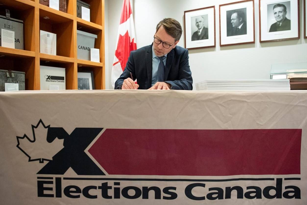 Chief Electoral Officer Stephane Perrault signs the writs of the 43rd general election during a photo opportunity in Gatineau, Que., Friday, Sept. 20, 2019. Canadians may have to wait a few days to find out the final results of a federal election called in the midst of the COVID-19 pandemic, Canada's chief electoral officer warns. THE CANADIAN PRESS/Justin Tang