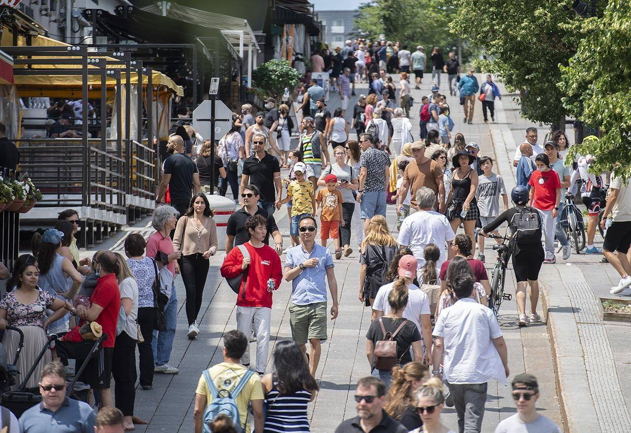 Pedestrians walk in Place Jacques-Cartier in Old Montreal, Sunday, July 4, 2021, as the COVID-19 pandemic continues in Canada and around the world. THE CANADIAN PRESS/Graham Hughe