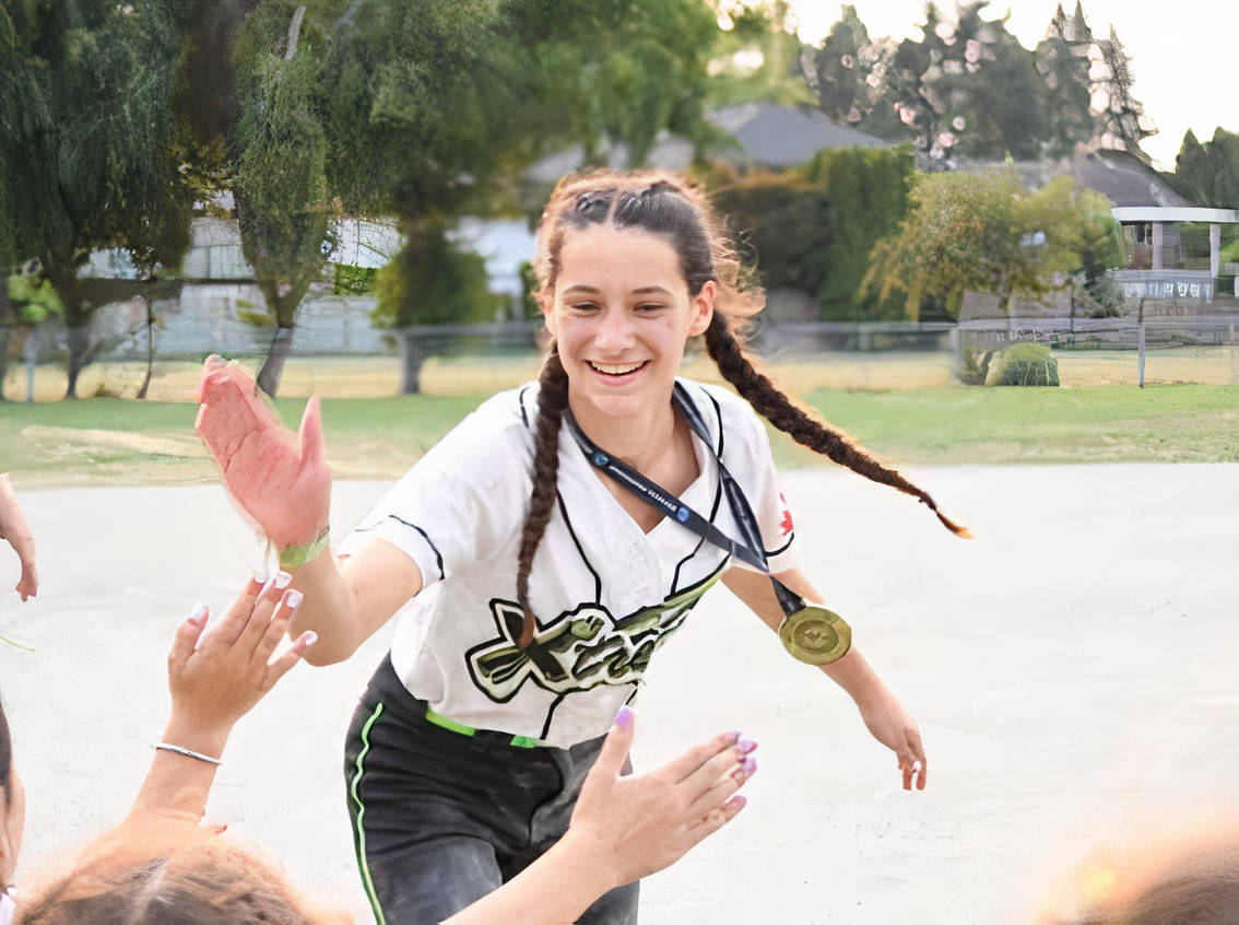 Langley Xtreme '09 Alayana Jackson celebrated her team's gold medal win. Jackson scored eight home runs during the U12B provincial championships. (Jami Savage/special to Langley Advance Times)
