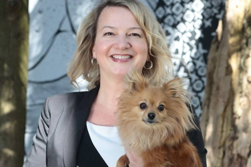 Marcie Moriarty and her dog Pip posing outside the BC SPCA in Vancouver, B.C. (supplied image)