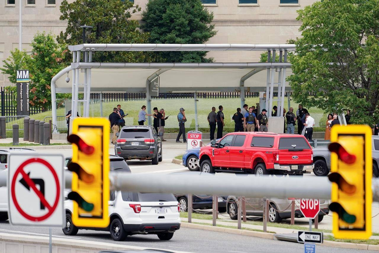 Police vehicles are seen outside the Pentagon Metro area Tuesday, Aug. 3, 2021, at the Pentagon in Washington. The Pentagon is on lockdown after multiple gunshots were fired near a platform by the facility's Metro station. (AP Photo/Andrew Harnik)