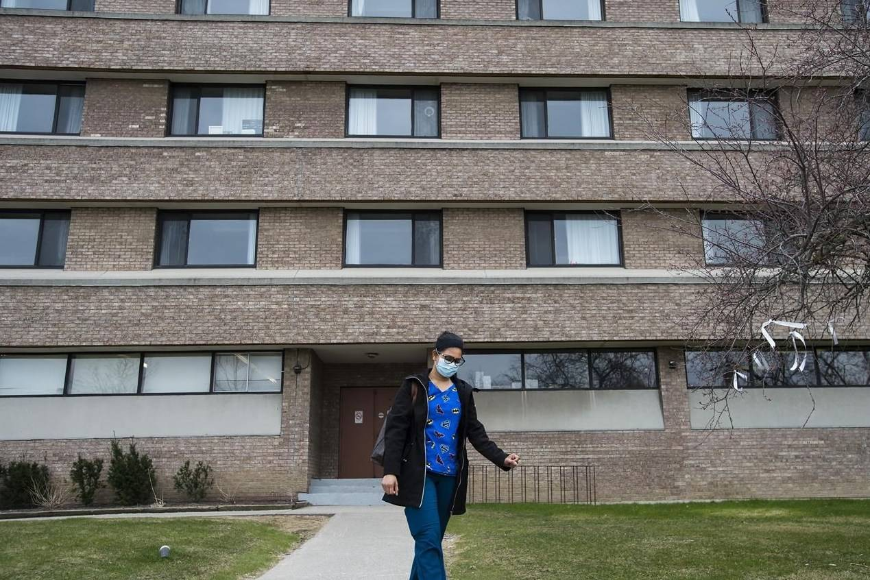 A health care worker leaves after finishing her shift for the day at the Eatonville Care Centre in Toronto on Friday, April 24, 2020. A report published this morning by parliamentary budget officer Yves Giroux estimates ending wait lists, increasing staff pay and benefits, providing more hours of care each day and expanding home care could cost around $13.7 billion. THE CANADIAN PRESS/Nathan Denette