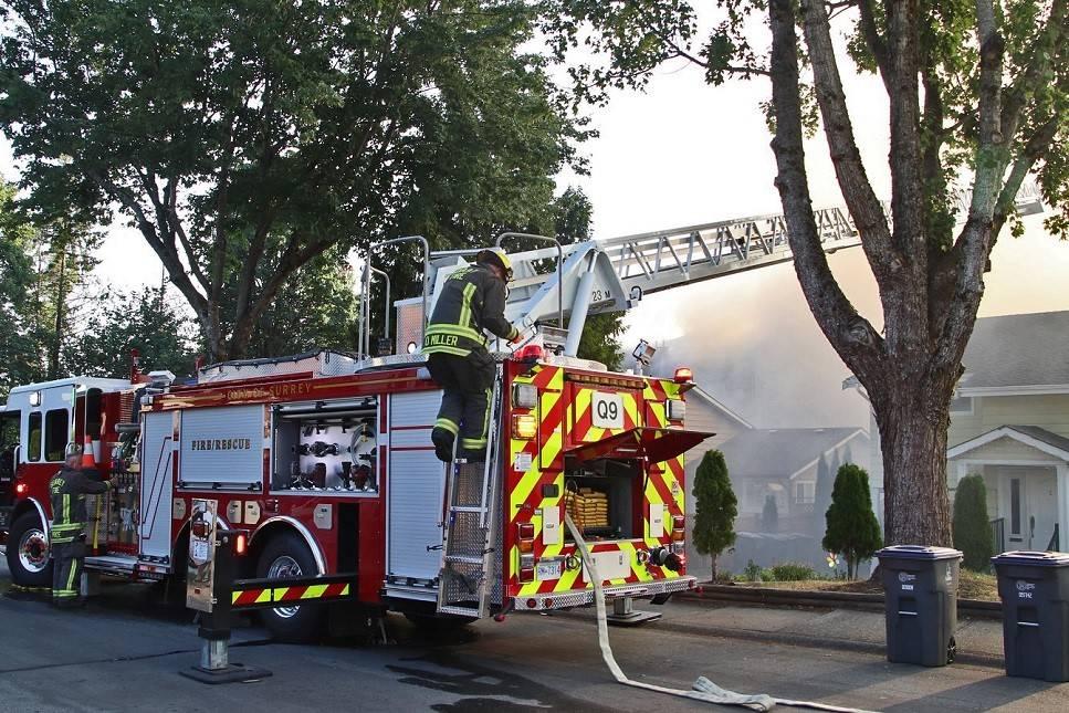 Surrey firefighters battle a blaze at a Newton condo complex Tuesday, Aug. 3, 2021. (Photo: Shane MacKichan)
