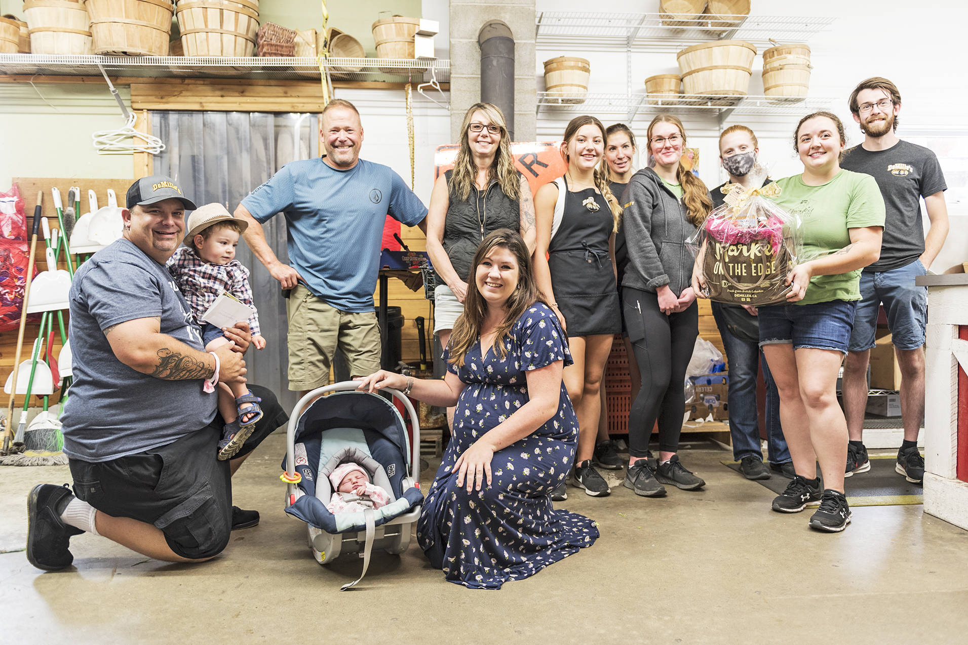 Brad DeMille (third from left) and staff have their photo taken with the Robertson family, after congratulating them on the birth of their daughter, on Wednesday, Aug. 4, 2021. (Lachlan Labere-Salmon Arm Observer)