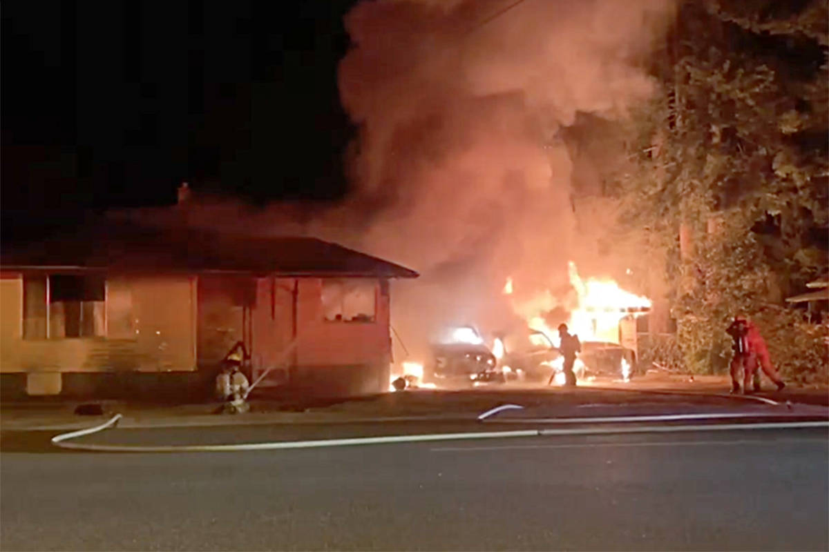Mission firefighters can be seen here dousing the flames. The Mission RCMP Serious Crime Unit has taken control of the investigation. Screenshot from Facebook video.