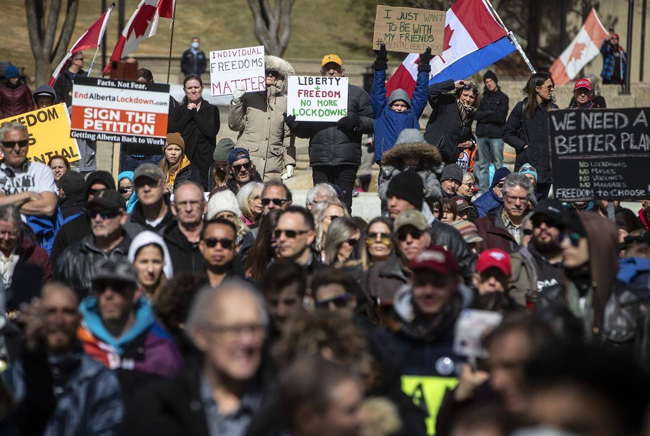 Anti-lockdown and anti-mask protesters take part in a rally outside the Alberta Legislature in Edmonton on Monday, April 12, 2021. THE CANADIAN PRESS/Jason Franson