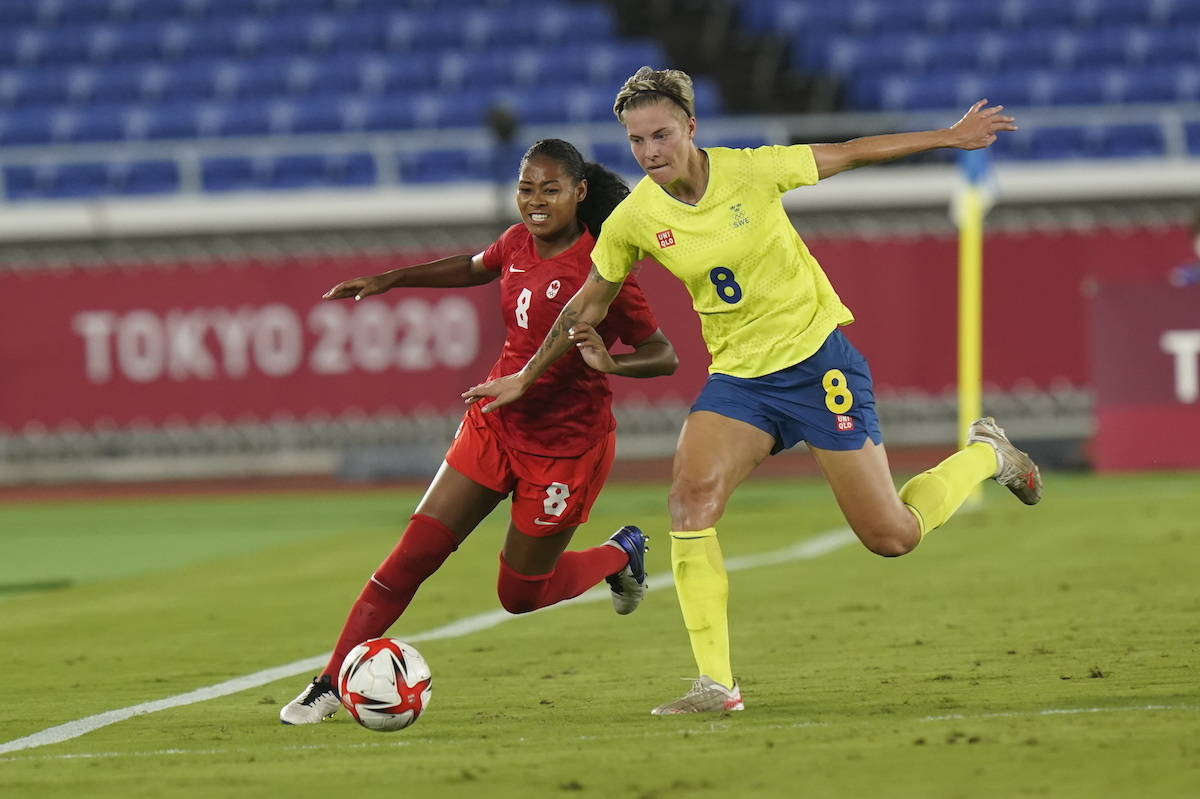 Canada's Jayde Riviere (left) and Sweden's Lina Hurtig battle for the ball in the extra time period during the women's soccer gold medal game at the Tokyo Olympics in Yokohama, Japan on Friday, August 6, 2021. THE CANADIAN PRESS/Adrian Wyld