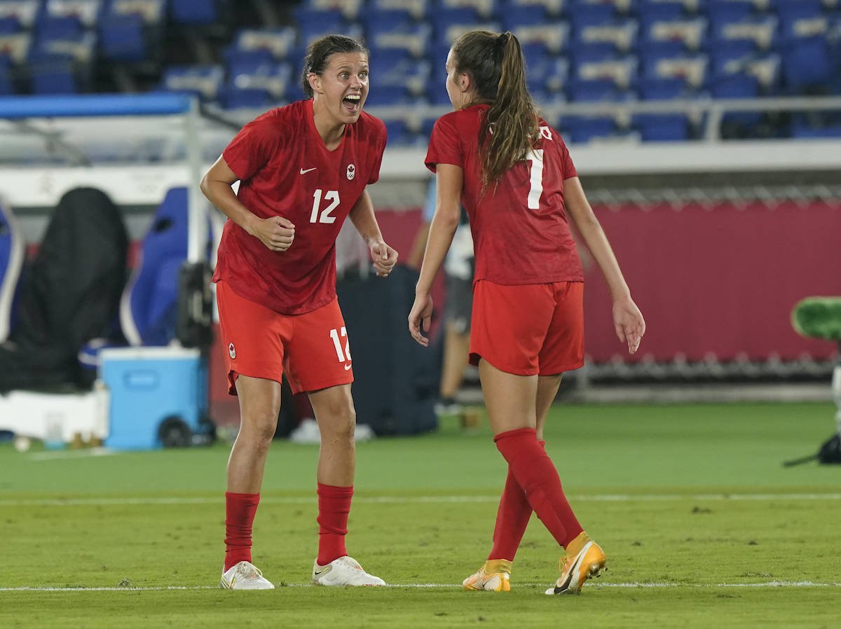 Canada's Christine Sinclair (right) celebrates with Julia Grosso, who scored the winning penalty kick goal against Sweden, during the women's soccer gold medal game at the Tokyo Olympics in Yokohama, Japan on Friday, August 6, 2021. THE CANADIAN PRESS/Adrian Wyld
