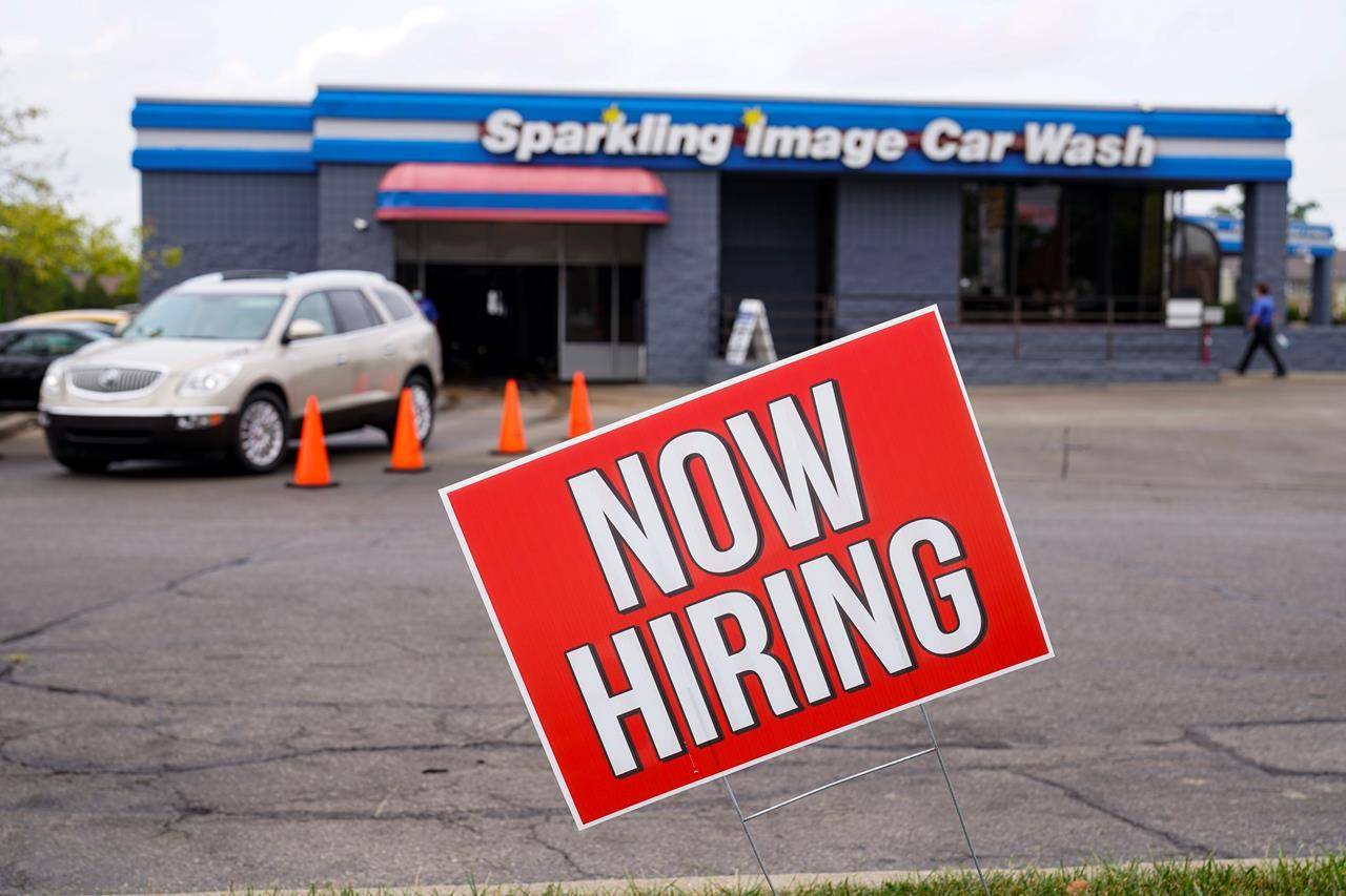 A help wanted sign is displayed at car wash in Indianapolis, Wednesday, Sept. 2, 2020. Statistics Canada will reveal this morning how the labour market fared in July as restrictions meant to quell the COVID-19 pandemic were rolled back in many provinces. THE CANADIAN PRESS/AP-Michael Conroy