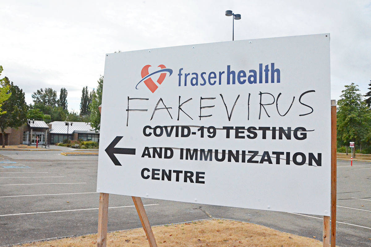 A sign directing people to Langley City's vaccination and COVID testing centre at Kwantlen Polytechnic University was vandalized in early August 2021. (Matthew Claxton/Langley Advance Times)