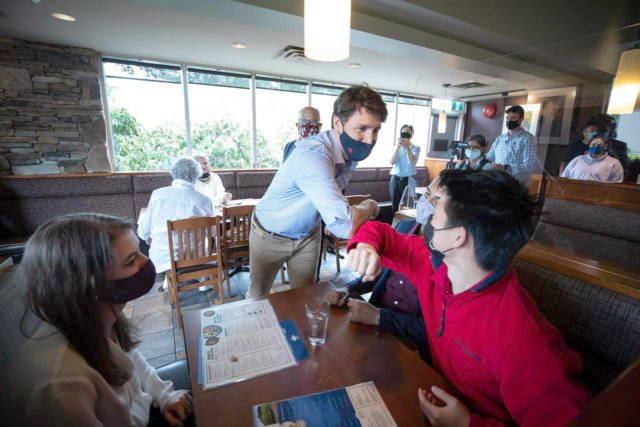 Prime Minister Justin Trudeau greets people having lunch at a White Spot restaurant in Coquitlam, B.C., on July 8. Canadian party leaders are working worked their way around the country, in what some see as the proof they needed that a federal election is on its way. (Darryl Dyck - The Canadian Press)