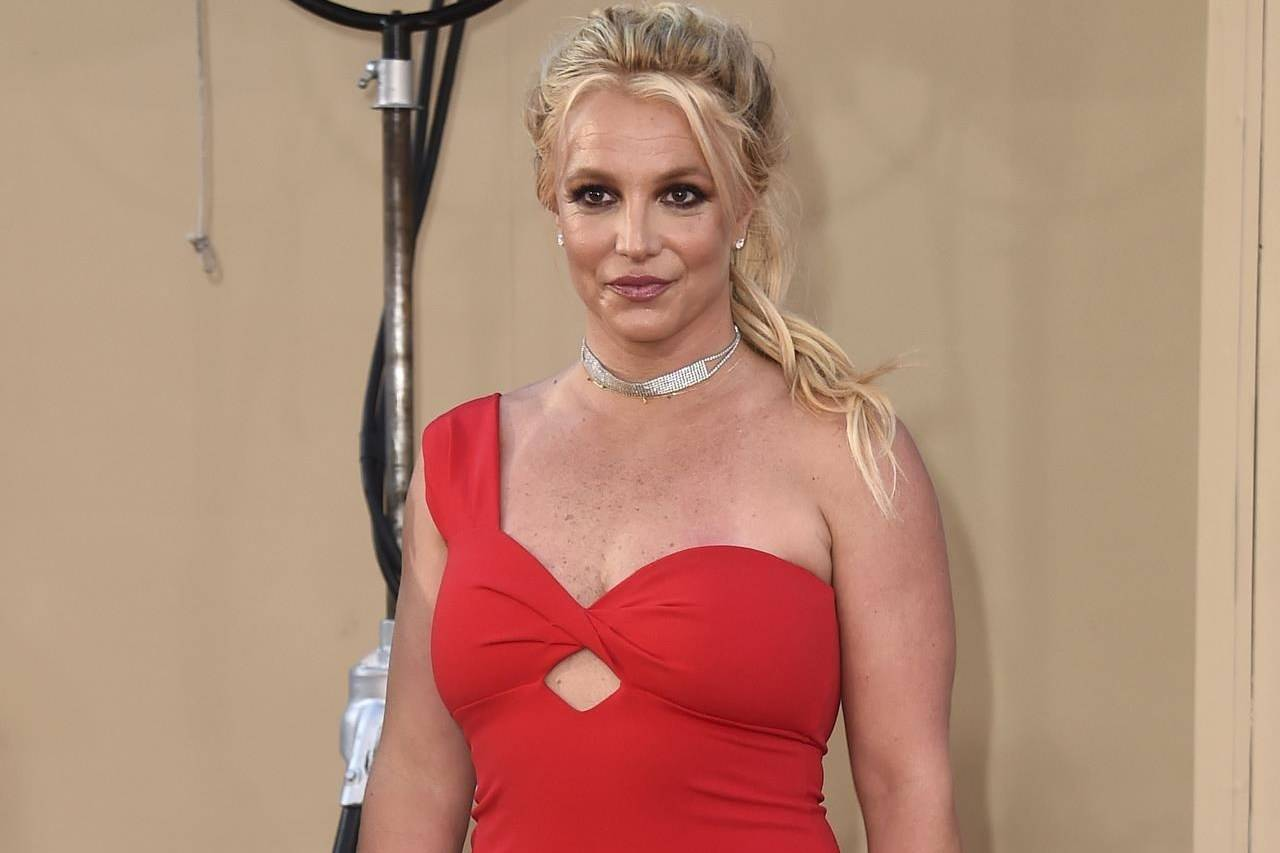 """FILE - Britney Spears arrives at the Los Angeles premiere of """"Once Upon a Time in Hollywood"""" on July 22, 2019. When Spears speaks to a judge at her own request on Wednesday, June. 23, 2021, she'll do it 13 years into a court-enforced conservatorship that has exercised vast control of her life and money by her father. Spears has said the conservatorship saved her from collapse and exploitation. But she has sought more control over how it operates, and says she wants her father out. (Photo by Jordan Strauss/Invision/AP, File)"""
