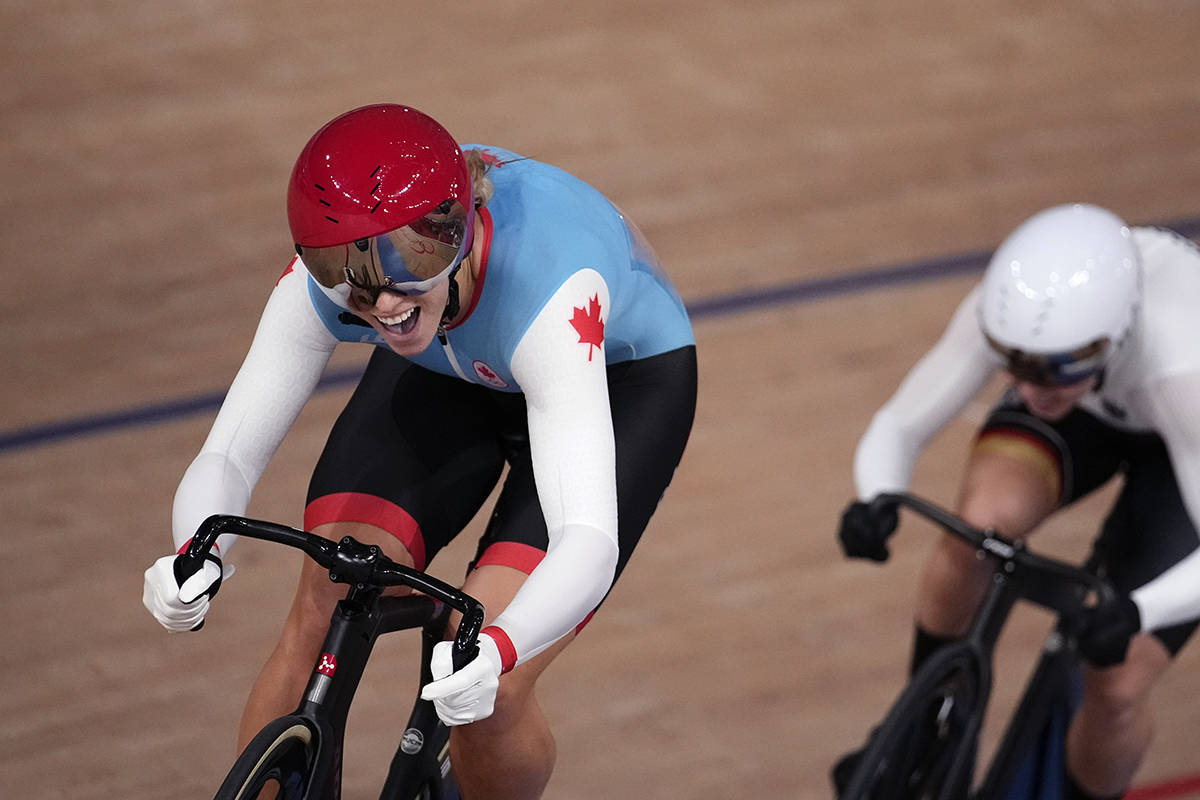 Kelsey Mitchell of Team Canada competes during the track cycling women's sprint race at the 2020 Summer Olympics, Sunday, Aug. 8, 2021, in Izu, Japan. (AP Photo/Christophe Ena)
