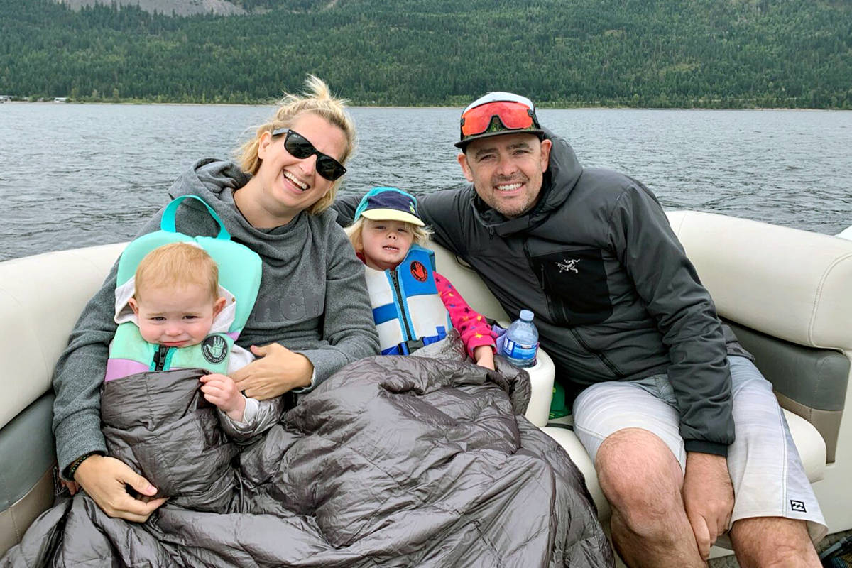 Erin Easingwood, husband Stu, with Lily and Ellie. The Langley lawyer retired from the profession after 15 years to go sailing full-time with her family. (www.skookumsailing.ca/Special to Langley Advance times)