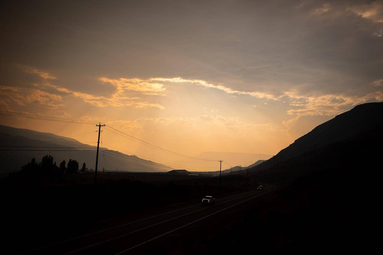 Smoke from wildfires burning in the area fills the air while motorists travel on the Trans-Canada Highway near Walhachin, B.C., on July 15, 2021. THE CANADIAN PRESS/Darryl Dyck