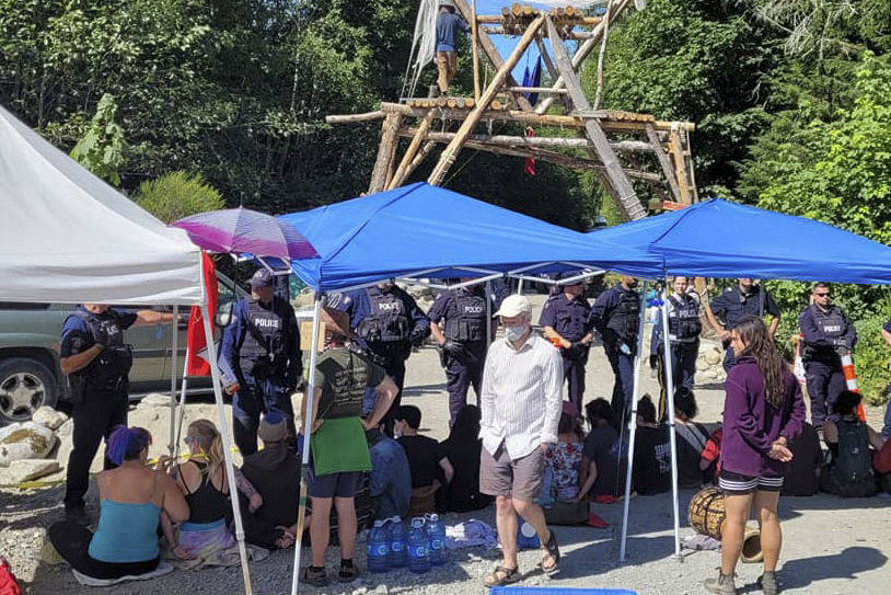 Police square off with protesters during enforcement at the Fairy Creek watershed on the morning of Monday, Aug. 9. (ONE DAY to Save the Old Growth Facebook group)